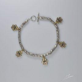 Bracciale intercalri in argento con zampine in oro 9 Kt